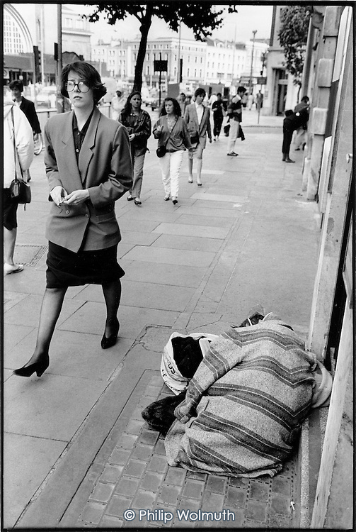 Elderly woman with mental health problems sleepinng rough on Euston Road, King's Cross, London 1990.