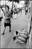 Elderly woman with mental health problems sleepinng rough on Euston Road, King's Cross, London 1990.
