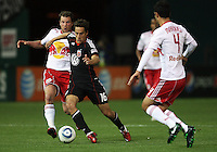 Josh Wolfe (16) of D.C. United breaks past Teemu Tainio (2) and Rafa Marquez (4) of the New York Red Bulls during an MLS match at RFK Stadium, in Washington D.C. on April 21 2011. Red Bulls won 4-0.
