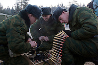 Kamenka, Karelia, Russia, 14/12/2007..Professional Russian soldiers preparing machine-gun belts during Snezhinka [Snowflake] 2007, a joint live fire training exercise for Russian and Swedish motorised infantry in which they play the roles of a combined peace-keeping force enforcing a demilitarised zone in a warring region.