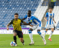19th December 2020 The John Smiths Stadium, Huddersfield, Yorkshire, England; English Football League Championship Football, Huddersfield Town versus Watford; Andre Gray of Watford  shielding the ball from Mouhamadou-Naby Sarr