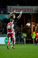 Friday 03 January 2014<br /> Pictured: Alun wyn Jones tries to block Rhys Preistland's advance<br /> Re: Ospreys v Scarlets, Rabo Direct Pro 12 match at the Liberty Stadium Swansea, Wales