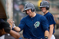 Donny Lucy #27 of the Charlotte Knights hive fives a teammate after hitting a solo home run in the 5th inning against the Columbus Clippers at Knights Stadium May 25, 2010, in Fort Mill, South Carolina.  Photo by Brian Westerholt / Four Seam Images