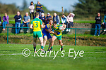 Gneeveguilla's Patrick Brosnan under pressure from St Senan's Ronan Kerins as he clears his defence in the County Premier Junior football Quarter Final