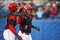 Batavia Muckdogs catcher Pablo Garcia (7) high fives Isaiah White (18) after scoring a run during a game against the West Virginia Black Bears on June 29, 2016 at Dwyer Stadium in Batavia, New York.  West Virginia defeated Batavia 9-4.  (Mike Janes/Four Seam Images)