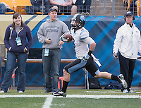 North Carolina punt returner Ryan Switzer returns a first quarter punt 65 yards for a touchdown. The North Carolina Tar Heels defeated the Pitt Panthers 34-27 at Heinz Field, Pittsburgh Pennsylvania on November 16, 2013.