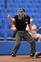 Home plate umpire Brennan Miller makes a call during a game between the Brevard County Manatees and Dunedin Blue Jays on April 11, 2014 at Florida Auto Exchange Stadium in Dunedin, Florida.  Brevard County defeated Dunedin 5-2.  (Mike Janes/Four Seam Images)