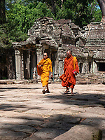 "Buddhist Monks visiting Preah Khan in the Angkor Wat temple area Preah Khan was built on the site of Jayavarman VII's victory over the invading Chams in 1191. Unusually the modern name, meaning ""holy sword"", is derived from the meaning of the original—Nagara Jayasri (holy city of victory). The site may previously have been occupied by the royal palaces of Yasovarman II and Tribhuvanadityavarman."