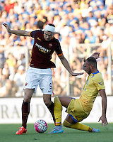 Calcio, Serie A: Frosinone vs Roma. Frosinone, stadio Comunale, 12 settembre 2015.<br /> Roma's Edin Dzeko, left, is challenged by Frosinone's Leonardo Blanchard during the Italian Serie A football match between Frosinone and Roma at Frosinone Comunale stadium, 12 September 2015.<br /> UPDATE IMAGES PRESS/Isabella Bonotto