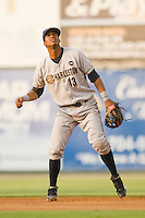 Second baseman Jimmy Paredes #13 of the Charleston RiverDogs watches the flight of a fly ball against the Kannapolis Intimidators at Fieldcrest Cannon Stadium May 29, 2010, in Kannapolis, North Carolina.  Photo by Brian Westerholt / Four Seam Images