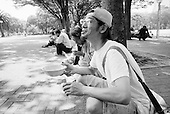 """Nagoya, Japan.June 14, 2009..Rev. Shinji Kinjyo of """"Toukai Chino Hate Senkyou Kyoukai"""" ( End of the Earth Mission Church ) organizes a mass and soup-run for the homeless at Shirakawa Park near Nagoya station. He claims to have been doing a Soup-run for 4 years, twice a week. Recently, he has started to see new people in 20's since the economy had gone bad...Yuji Kobayashi, 38, who had worked at auto parts supplier for Toyota and Honda. Recently lost job his job as a temporary worker has been living and sleeping at the street near Nagoya station. In Shirakawa Park he receives food. He is originally from Kyushu but never thought of going back home because he thinks that he wouldn't have any job there."""