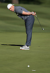 Cincinnati Bengal's A.J. Hawk talks to his ball after a putt in the final round of the American Century Championship at Edgewood Tahoe Golf Course in Stateline, Nev., on Sunday, July 19, 2015. <br /> Photo by Cathleen Allison