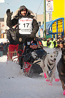 Musher Lance Mackey and Iditarider Alan Docter.leave the 2011 Iditarod ceremonial start line in downtown Anchorage, Alaska