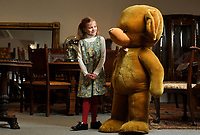 BNPS.co.uk (01202 558833)<br /> Pic: ZacharyCulpin/BNPS<br /> <br /> Super Ted - A giant teddy bear that was commissioned to be made by a doting grandfather over 50 years ago has emerged for sale.<br /> <br /> The vendor's grandfather had the 4ft tall Merrythought golden mohair stuffed toy made in 1969 and gifted it to his grandchildren.<br /> <br /> It has been passed down the generations since then and is now being sold with auctioneers Woolley & Wallis, of Salisbury, Wilts.