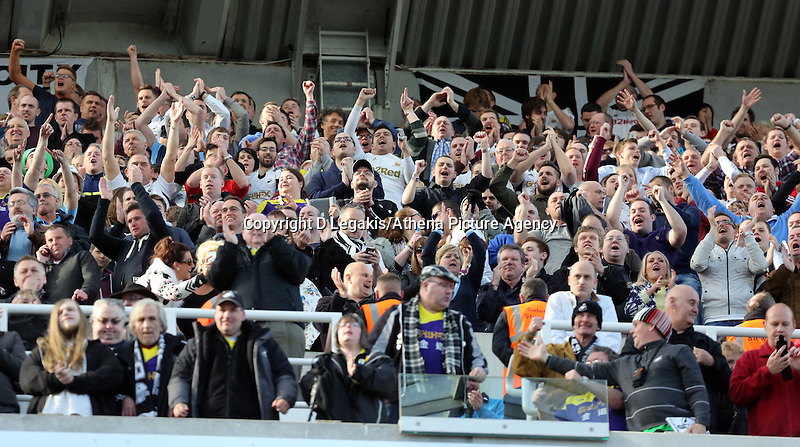 Pictured: Ecstatic Swansea supporters celebrating their win after the final whistle. Saturday 19 April 2014<br /> Re: Barclay's Premier League, Newcastle United v Swansea City FC at St James Park, Newcastle, UK.