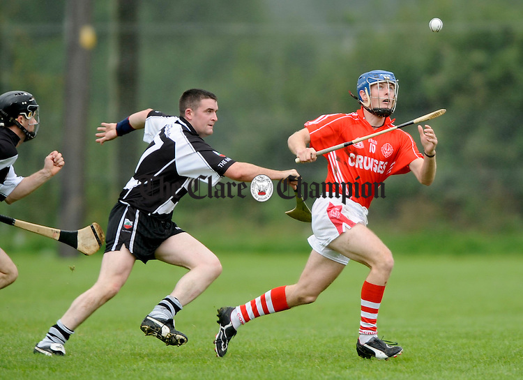 Clarecastle's Alan O Loughlin gives chase to Eire Og's Adrian Flaherty during their championship game at Gurteen. Photograph by John Kelly.