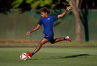 KASHIMA, JAPAN - AUGUST 1: Catarina Macario #19 of the USWNT strikes the ball during a training session at the practice field on August 1, 2021 in Kashima, Japan.