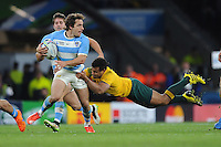 Nicolas Sanchez of Argentina is tackled by Will Genia of Australia during the Semi Final of the Rugby World Cup 2015 between Argentina and Australia - 25/10/2015 - Twickenham Stadium, London<br /> Mandatory Credit: Rob Munro/Stewart Communications