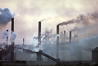 Smoke and dust pour from Gary Steel Works, US Steel Corporation, Gary Indiana, 1966. The Steel Works covered 1500 acres of the south shore of Lake Michigan, employed nearly 20,000 and operated around the clock, 365 days a year. Photo by John G. Zimmerman.