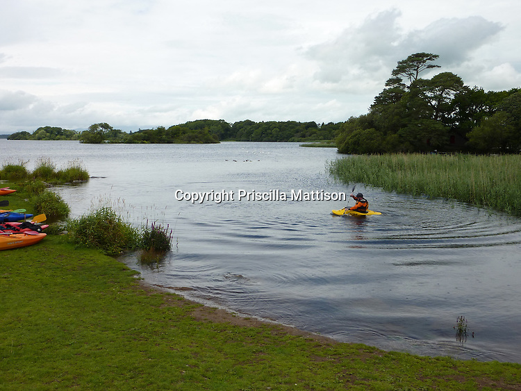 County Kerry, Republic of Ireland - July 19, 2010:  A kayaker paddles on Lough Leane in Killarney National Park.