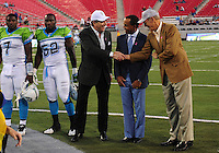 Oct. 8, 2009; Las Vegas, NV, USA; California Redwoods owner Paul Pelosi (left) shakes hands with UFL executive Bill Hambrecht (right) as UFL commissioner Michael Huyghue looks on prior to the game against the Las Vegas Locomotives in the inaugural United Football League game at Sam Boyd Stadium. Mandatory Credit: Mark J. Rebilas-