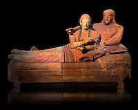 6th century BC Etruscan Sarcophagus known as The Sarcophagus of the Spouses, the in sculpted in clay by the sculptors of Caere, 520-510 BC, Louvre Museum, Paris.  Black background. To license for Advertising usage contact The Louvre Paris