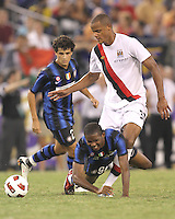 Samuel Eto'o #9 of Inter Milan is pulled down by Vincent Kompany #33 of Manchester City during an international friendly match on July 31 2010 at M&T Bank Stadium in Baltimore, Maryland. Milan won 3-0.