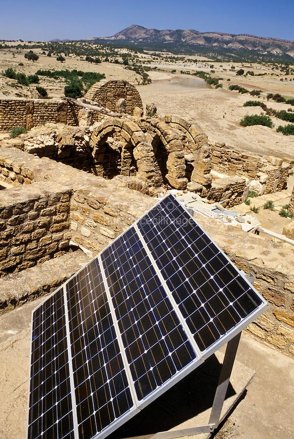 Tunisia, Le Kef.  Hammam Mellegue, Roman Era Baths.  Solar Power Panel in Foreground, Roman Arches in Background.