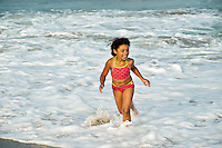 Young girl enjoys the ocean water, Cape Cod, MA, USA
