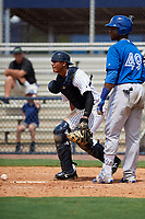 GCL Yankees East catcher Hemmanuel Rosario (11) tracks down a loose ball during the second game of a doubleheader against the GCL Blue Jays on July 24, 2017 at the Yankees Minor League Complex in Tampa, Florida.  GCL Yankees East defeated the GCL Blue Jays 7-3.  (Mike Janes/Four Seam Images)