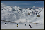 Stage Technique.<br /> Compose your photo and let the world pass by or ski by, while you make 3-5 exposures. Don't move the camera and pick the best. <br /> Skiing the Der Weise Ring (the White Ring Route) from Zurs to Lech, Austria.