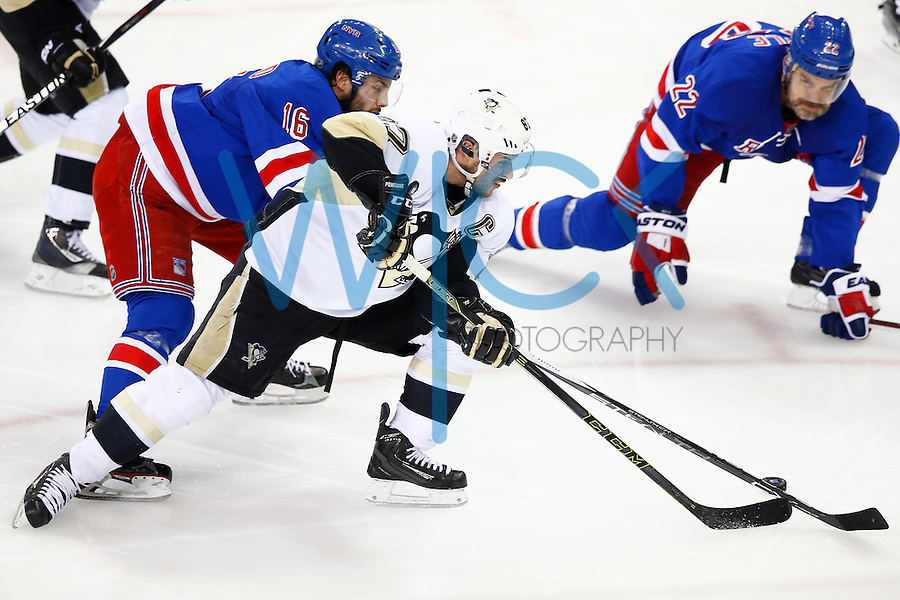 Sidney Crosby #87 of the Pittsburgh Penguins carries the puck past Derick Brassard #16 of the New York Rangers in the second period during game four of the first round of the Stanley Cup Playoffs at Madison Square Garden in New York City on April 21, 2016. (Photo by Jared Wickerham / DKPS)