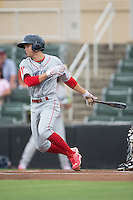 Scott Kingery (18) of the Lakewood BlueClaws follows through on his swing against the Kannapolis Intimidators at Intimidators Stadium on July 14, 2015 in Kannapolis, North Carolina.  The Intimidators defeated the BlueClaws 8-2.  (Brian Westerholt/Four Seam Images)