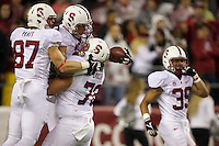 Stanford wide receiver Devon Cajuste, second from left, celebrates a touchdown with teammates Jordan Pratt, far left, and Kevin Danser during play against Washington State at CenturyLink Field in Seattle Saturday September 28, 2013.