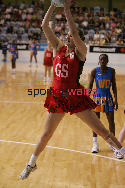 Rebecca James.Commonwealth Games Netball.Wales v Barbados.Melbourne Exhibition Centre.Melbourne.23.03.06.©Steve Pope.Steve Pope Photography.The Manor .Coldra Woods.Newport.South Wales.NP18 1HQ.07798 830089.01633 410450.steve@sportingwales.com.