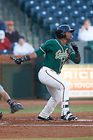 Isael Soto (15) of the Greensboro Grasshoppers follows through on his swing against the Augusta GreenJackets at First National Bank Field on April 10, 2018 in Greensboro, North Carolina.  The GreenJackets defeated the Grasshoppers 5-0.  (Brian Westerholt/Four Seam Images)