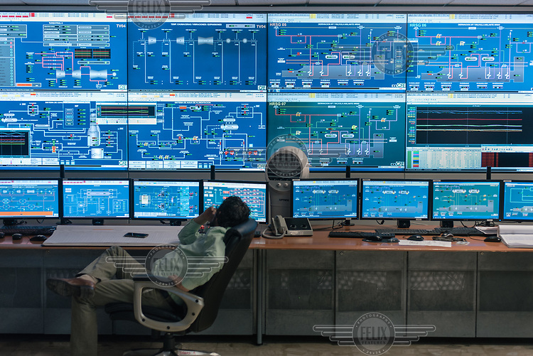 An employee monitors operations in the control centre of the Comision Federal de Electricidad (CFE) thermal power station.