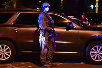 Washington, DC - June 1, 2020: A DEA agent stands a short distance from protesters gathered at 15th & Swann St. NW, Washington, DC  June 1, 2020, in the wake of the death of George Floyd by a Minnesota police officer.  (Photo by Don Baxter/Media Images International)