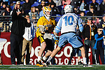 Face-Off Classic: Midfielder Greg Edmonds #10 Hopkins defends a UMBC Retriever  during the UMBC v Johns Hopkins mens lacrosse game at M&T Bank Stadium on March 10, 2012 in Baltimore, Maryland. (Ryan Lasek/ Eclipse Sportswire)