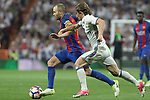 Andres Iniesta of FC Barcelona competes for the ball with Luka Modric of Real Madrid  during the match of La Liga between Real Madrid and Futbol Club Barcelona at Santiago Bernabeu Stadium  in Madrid, Spain. April 23, 2017. (ALTERPHOTOS)
