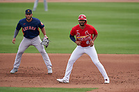 St. Louis Cardinals José Rondón (64) leads off in front of first baseman Abraham Toro (13) during a Major League Spring Training game against the Houston Astros on March 20, 2021 at Roger Dean Stadium in Jupiter, Florida.  (Mike Janes/Four Seam Images)