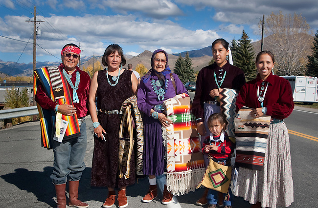 Navajo Family dressed in traditional clothing and turquoise participate in a parade with sheep