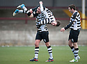 Shire's Max Wright (11) is lifted by Michael Hunter after he scores their first goal.