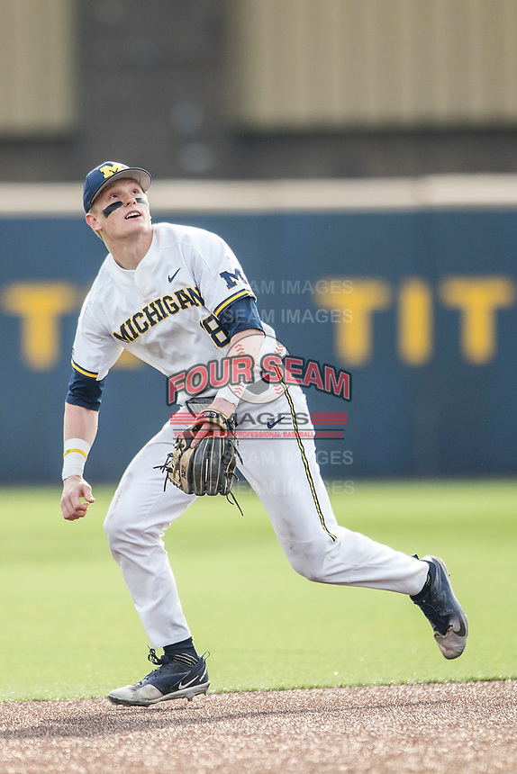 Michigan Wolverines shortstop Jack Blomgren (18) on defense against the Maryland Terrapins on April 13, 2018 in a Big Ten NCAA baseball game at Ray Fisher Stadium in Ann Arbor, Michigan. Michigan defeated Maryland 10-4. (Andrew Woolley/Four Seam Images)