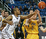 Nevada's Robyn Missa and Northwest Christian's Nick Sullivan scramble for a loose ball during a college basketball game in Reno, Nev., on Sunday, Dec. 28, 2014. Nevada won 81-67.<br /> Photo by Cathleen Allison