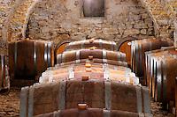 Domaine Cazeneuve in Lauret. Pic St Loup. Languedoc. Barrel cellar. France. Europe. Old vaulted stone cellar.