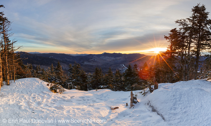 View from the summit of Mt Tecumseh in Waterville Valley, New Hampshire at sunrise during the winter months. This image consists of three images stitched together. Illegal tree cutting (vandalism) over the last few years has improved the view from this spot on the summit.