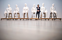 "26 April 2018, Germany, Wolfsburg: Indian artist Bharti Kher standing hehind her piece ""Six Women"". The exhibition ""Facing India"" at the Kunstmuseum Wolfsburg art museum runs from 29 April - 07 October. Photo: Hauke-Christian Dittrich/dpa"