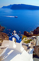 White buildings on the mountain cliffs of the small isolated town of Oia, Santorini, Greece