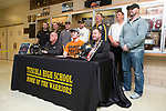 December 23, 2017- Tuscola, IL- Tuscola's Hunter Woodard with his coaches during his signing ceremony to play football at Oklahoma State. [Photo: Douglas Cottle]